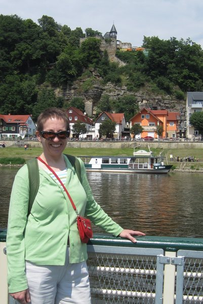 Waiting for the ferry to return so Lisa and I can float across the Elbe to the wine garden on top of the hill behind me. Rathen, Germany, May 2011. Thanks to Lisa Larsen for the photo.
