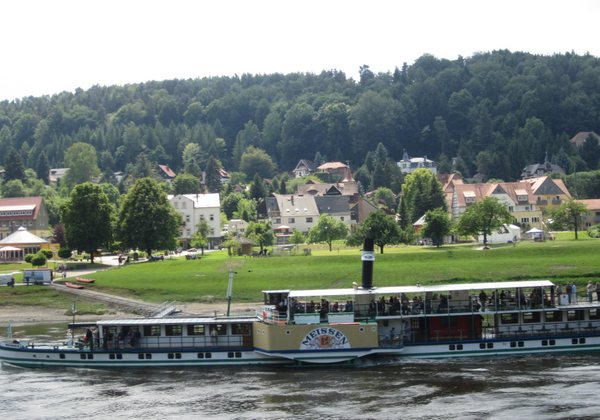 The steamboat back to Meissen arrives at the dock in Rathen, Germany. May 2011.