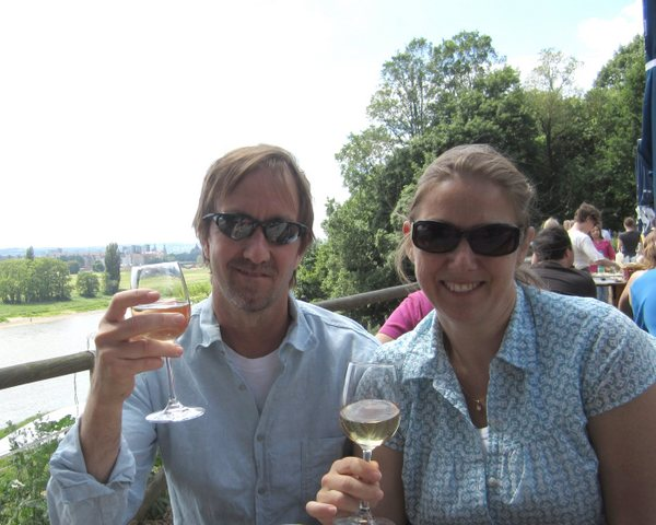 """My friends, Dave and Lisa toasting me at a wine garden on the Elbe River after our tour of the """"pleasure places."""" Dresden, Germany. May 2011."""