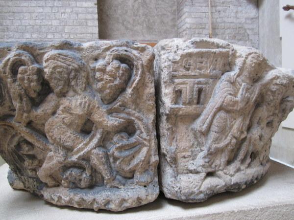 A cracked capital showing crude figures that used to top a column at the Abbey of Saint-Germain-des-Prés, Musée de Cluny / Musée national du Moyen Âge, Paris, France.
