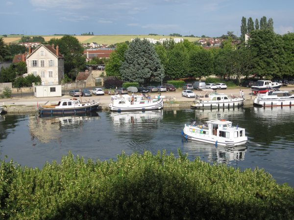 Looking out at the Yonne River from the boardwalk behind the Hôtel Le Maxime. It was a busy port the weekend I was there. Many boats were either traveling the river or tied up at the docks. Auxerre, France. June 2011