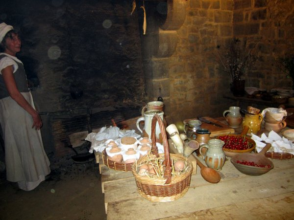 A cook baking bread and pies in the residence kitchen.