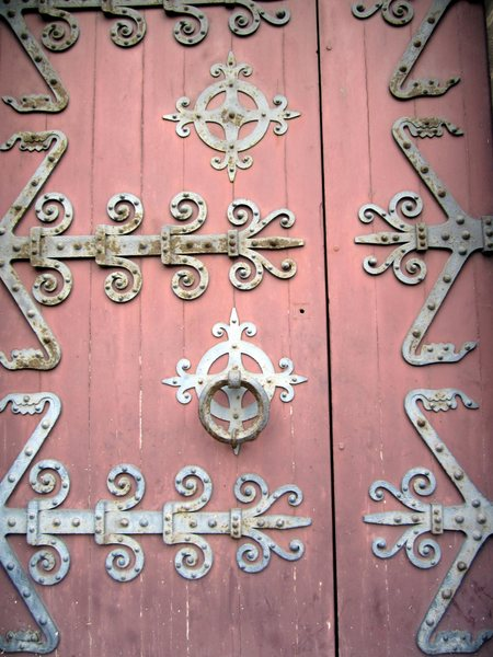 Door at the main entrance to the Abbey aux Dames featuring metal strapwork.