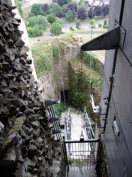 Looking down through the glass and steel structure built to help hold up the Falaise Chateau and to help visitors see its insides.