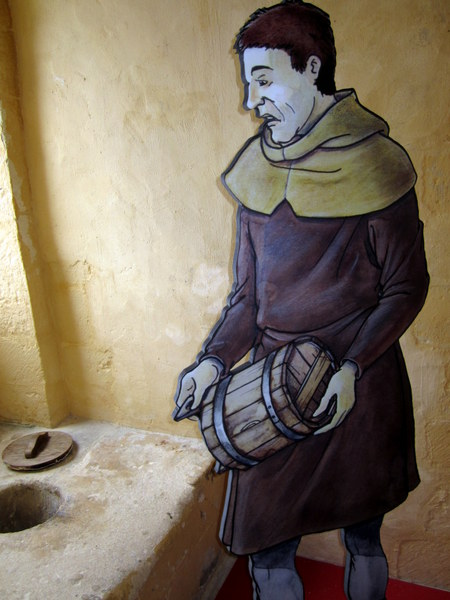 I imagine this is my antagonist, Maël, having to do his duty and clean the loo after he found his coat hanging there. Medieval folk thought that the uric acid protected clothing from vermin. That's why the privy was called a guarderobe or wardrobe...