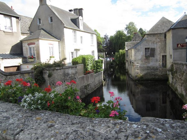 A view from one of the bridges over the Aure River, which flows through the old city center of Bayeux. Planters of flowers were everywhere.