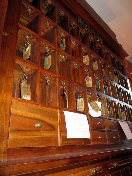A close-up of the key cabinet on the wall across from the front desk at the Hotel Churchill.