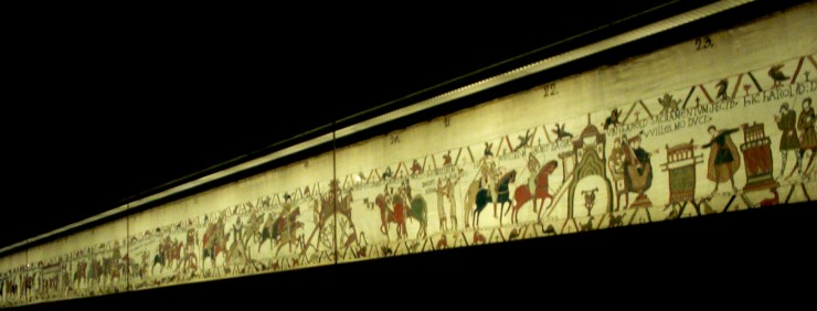 Picture of Bayeux tapestry behind glass at the museum in Bayeux, France. Photo by Dave of  Travelin' Tigers , 2002.