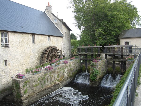 Water wheel along the Aure River in the center of Bayeux, France.