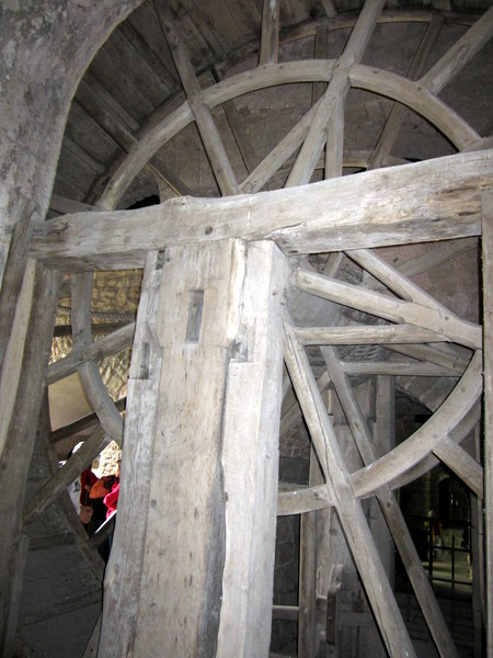 The wheel used to haul goods to the top of the Mont when there was a prison there.
