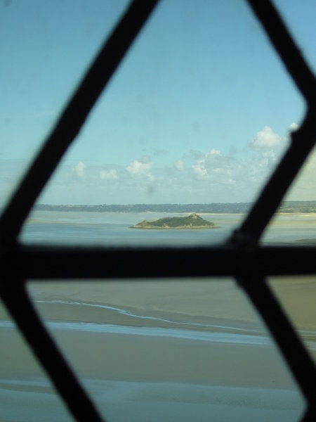 Another, smaller island, Tombelaine, spied through old glass near the main hall.
