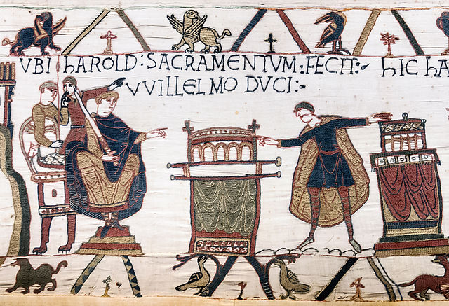 Harold touching two altars as he swore an oath to Duke William of Normandy in what appears to be Bayeux Cathedral. From the Bayeux Tapestry. By Myrabella - Own work, Public Domain.  Wikimedia commons.
