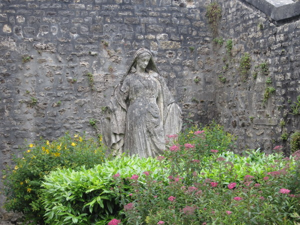 A statue of the Virgin Mary in a garden on my way to see the Bayeux Cathedral.