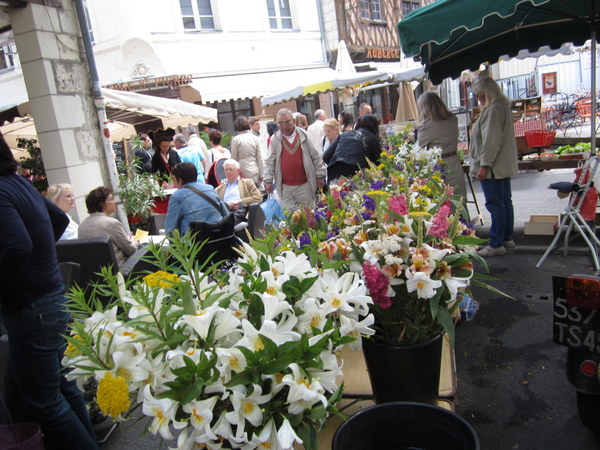 Enjoying the flowers at the Saturday Market Saumur, France.
