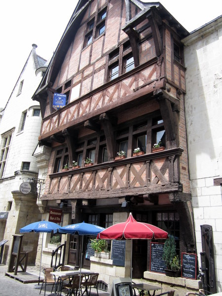 A half-timbered building in Chinon housing a beautiful cafe at street level and probably apartments above.
