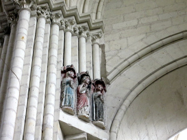 Figurines carved into an archway in the nave of the Church of St. Martin.