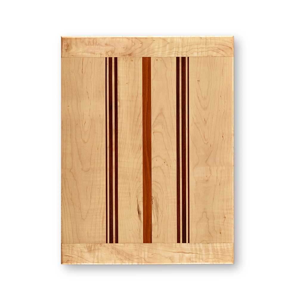 This particular serving board is in curly maple with a cherry stripe in the center and groups of black walnut on either side.