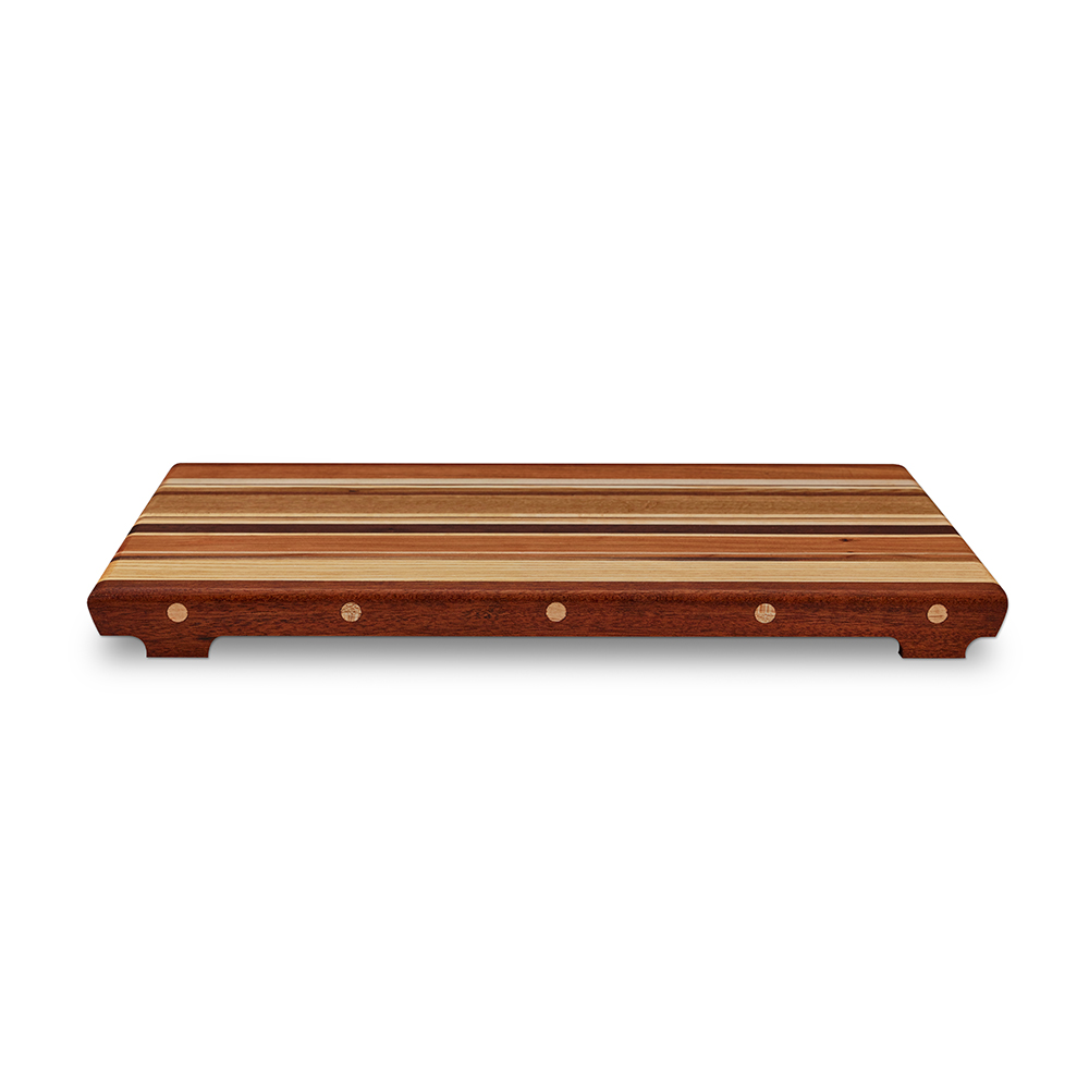 Each board has side rails with feet to keep juicy foods from sticking between the bottom and your counter top or table. This makes it easy to move from one place to the next without the mess.  Rails are bunged (plugged) with contrasting hardwood plugs making an attractive finish.