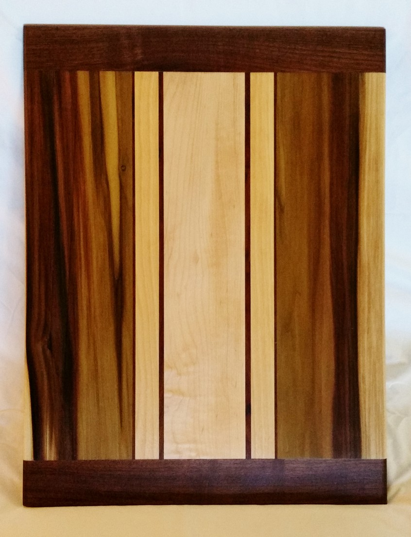 This unique board features a rich and diverse section of poplar heartwood coupled with black walnut, wavy maple and red birch
