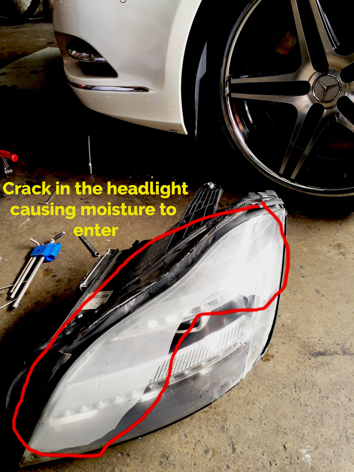 Existing headlamp that had a crack and resulted in the development of moisture inside the headlamp cover
