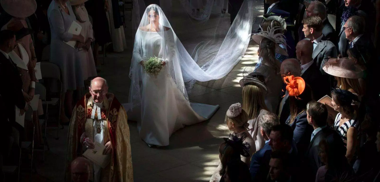 Meghan Markle's hand-embroidered silk veil trails 16 feet behind her with a finger-tip length sheer blusher.