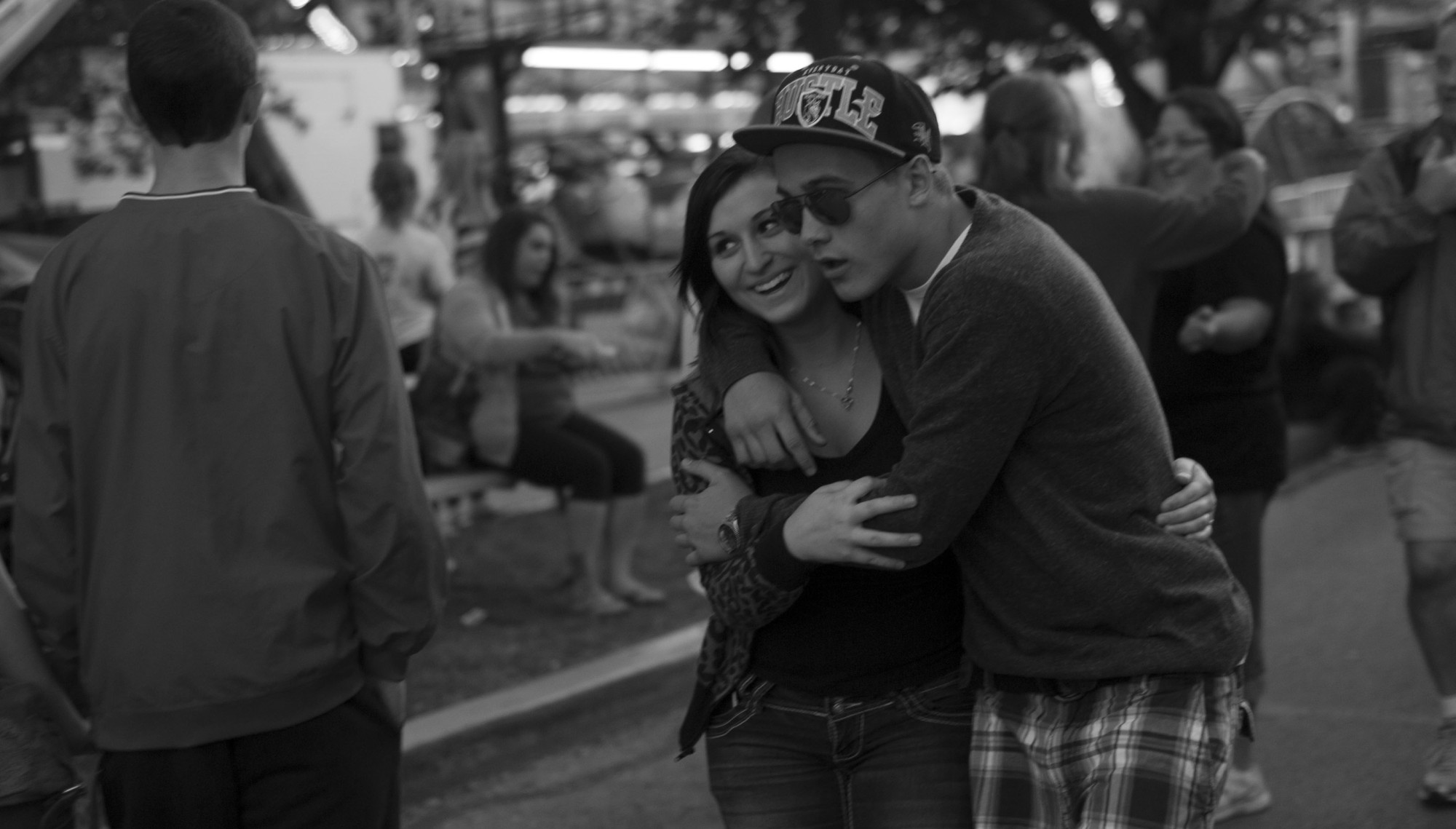 A young couple embraces during the Summer Fest in Evansville, Indiana.
