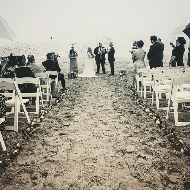 For just a moment in time, we were just a boy and a girl, running and laughing in the rain on our wedding day. - Mia Sheridan . #eliteweddings #beachwedding #virginaisforlovers #elitedjs #travelingdj #weddingphotography  #wedding #weddingdress #beachweddingdress #rainonweddingday #theknot #weddingwire #dreamwedding