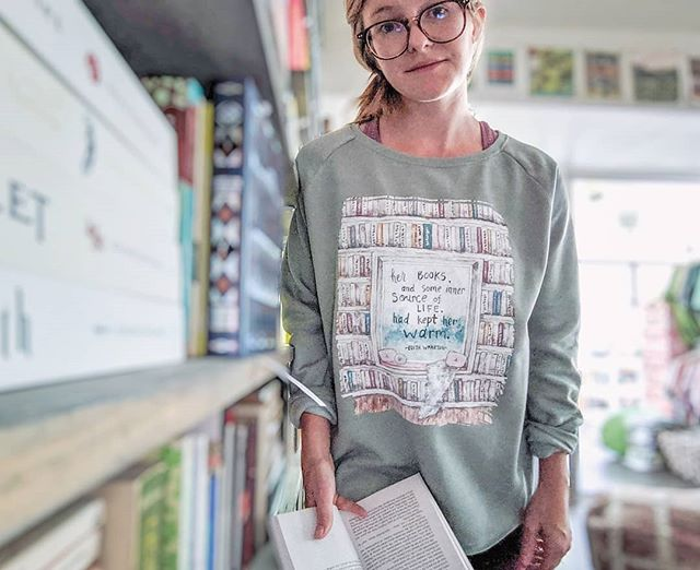 """Her books, and some inner source of life, had kept her warm."" . . You had to know I was going to make this into a sweatshirt! Books Kept Her Warm Crewneck on sage coming to the shop tomorrow, September 18th at 10am CST!  Don't you think this is an essential for any book lover in the fall? I don't know about you, but it describes my life to a tee 👌🏻 . . . . . . . . #fallfashion #fallreading #fallwhereyouat #falliscoming #fallreads #autumnvibes🍁 #anneofgreengables #lmmontgomery #sweetbookishandanne #libraryselfie #librarylife #homelibrary #homebeautiful #homelibrarygoals #homeart #darlinghome #bookishhome #bookishlife #bookishart #bookishallure #bookstagram"
