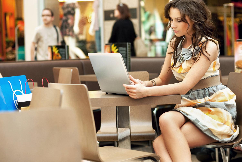 Elegant businesswoman working with laptop