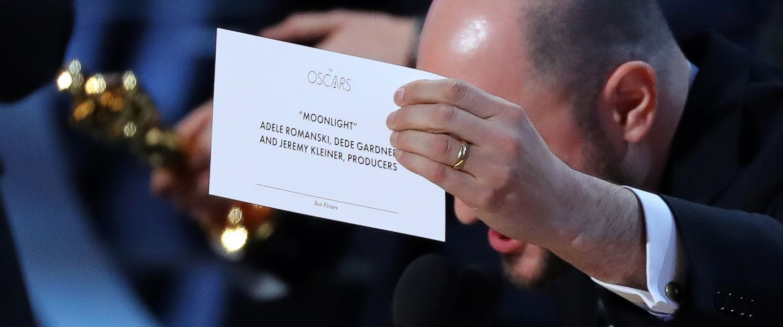A crew member holding the card showing  Moonlight  as the Best Picture winner.