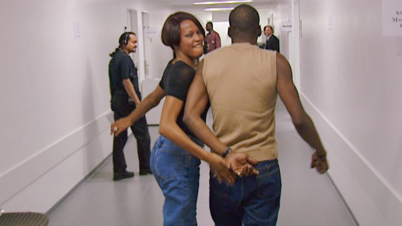 Houston with her husband, Bobby Brown, enjoying a funny, intimate moment. (Source: Google)