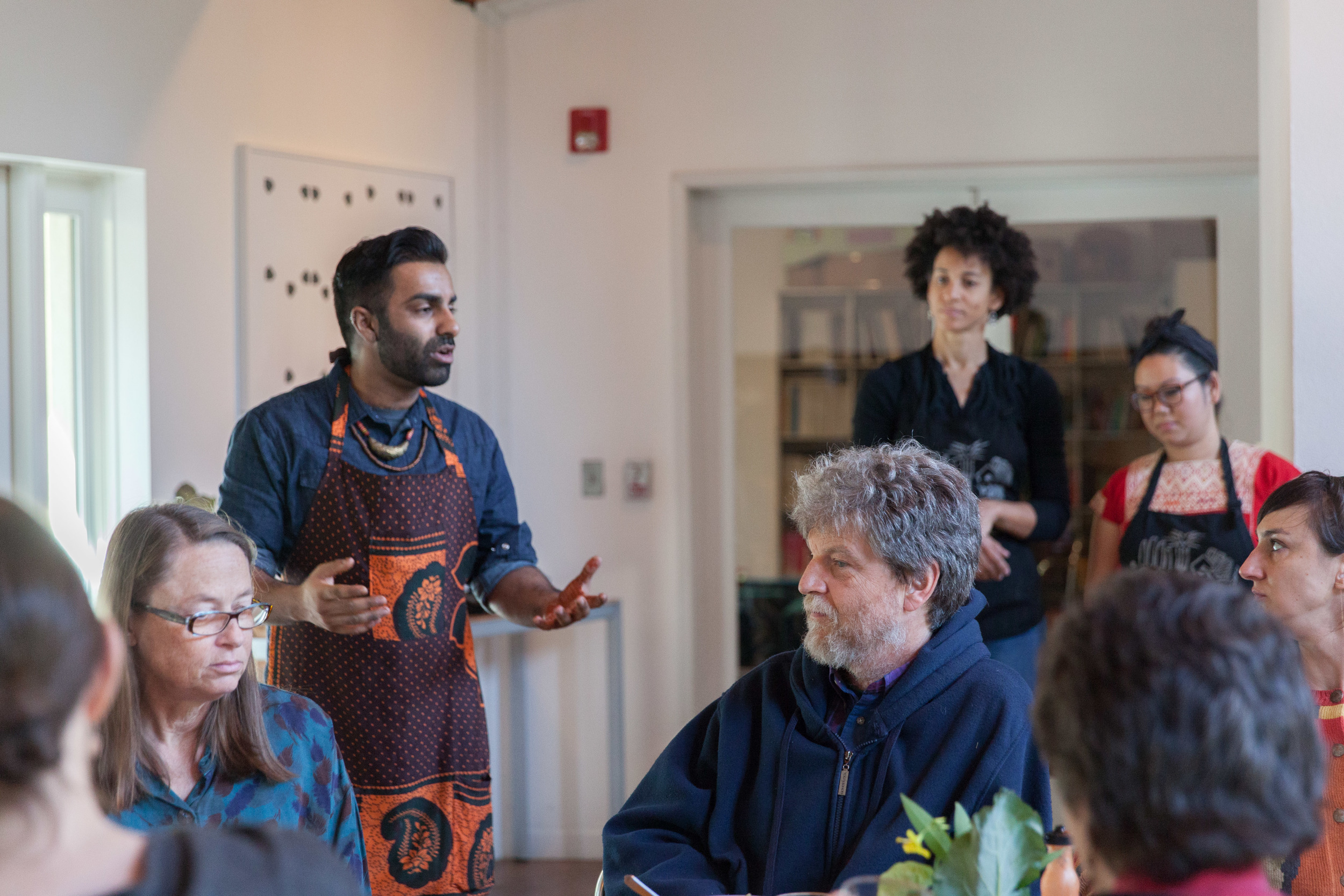 Saqib breaks down the history of the Black Panther's Free Breakfast Program.  Photo by Tina Case