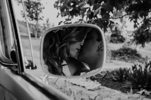 Objects in mirror are just as in love as they appear. 🧡 Photo by @samantha.josette #vwphotobooth #travelingphotobus #photoboothbus