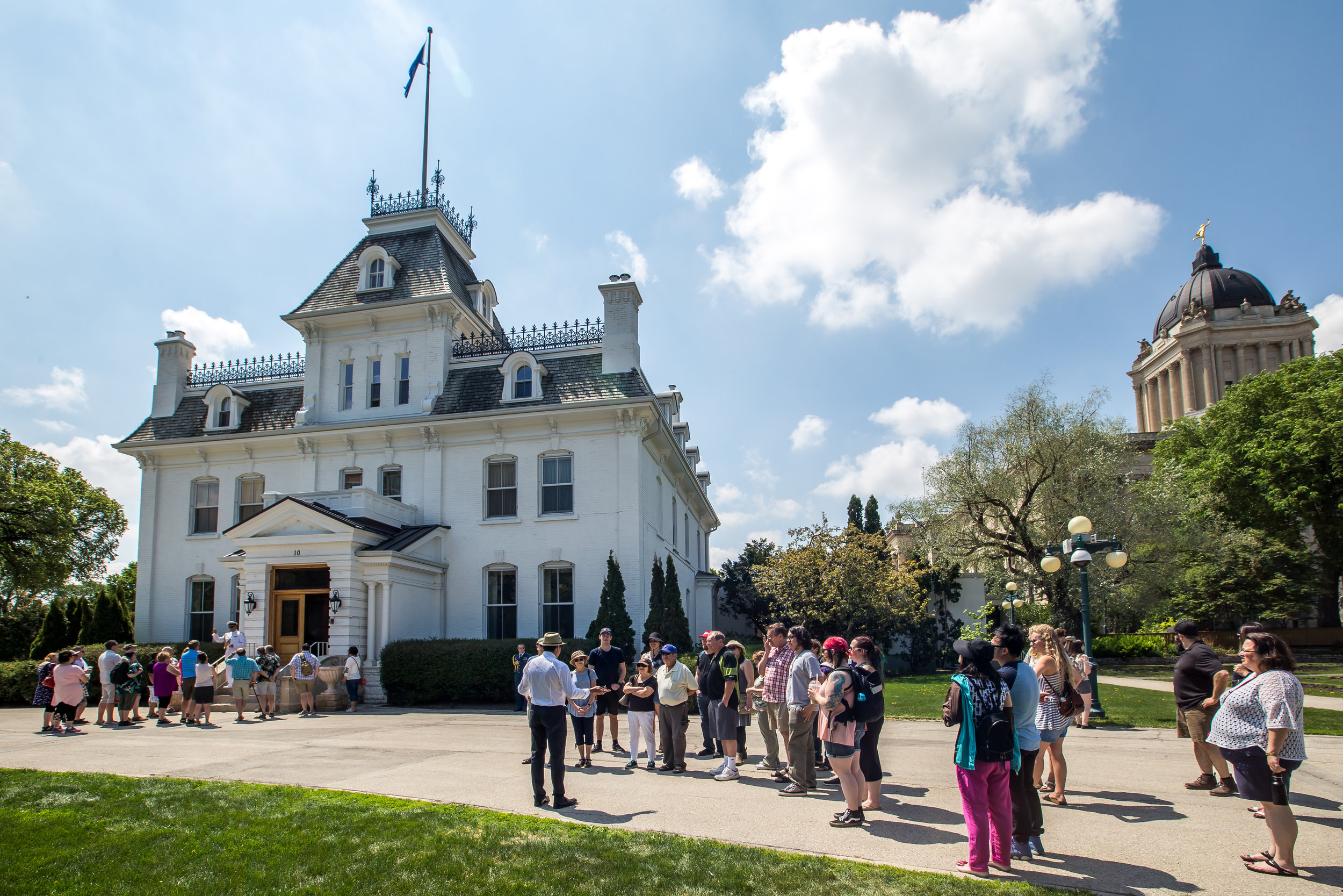 Guests line up outside Government House for tours during Doors Open - the official residence of the Lieutenant Governor of Manitoba.