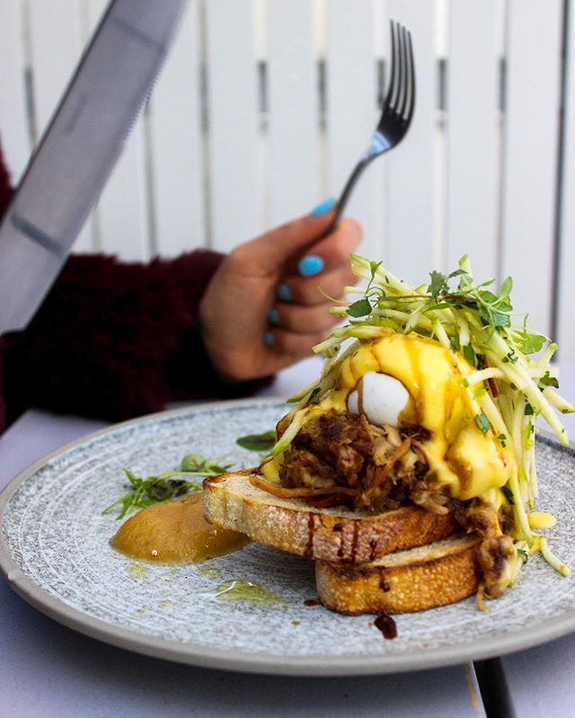 Slow-Cooked Pulled Pork Benedict on sourdough. 🍴 We hope you have a knife and fork held firmly in each hand. Time to cut through those mad Saturday brunch cravings. 🥚 🥚