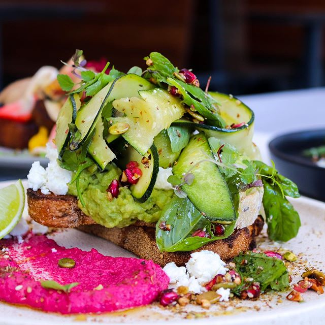 Sm'avo on Quinoa Toast w/ goats cheese, beetroot pesto, zucchini ribbon, herb salad, almond walnut and pepita crumble and lime. How Smashin'?! ⚡⚡⚡