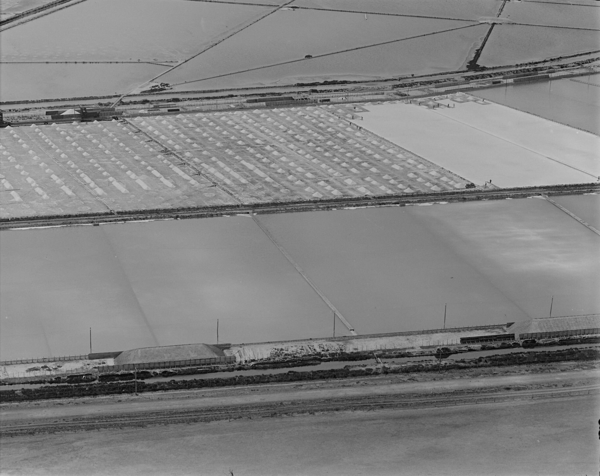 Photographed by Charles Daniel Pratt, (1935) ' Cheetham salt pans at Moolap and Point Henry with salt being harvested'  Photograph provided by  State Library of Victoria .