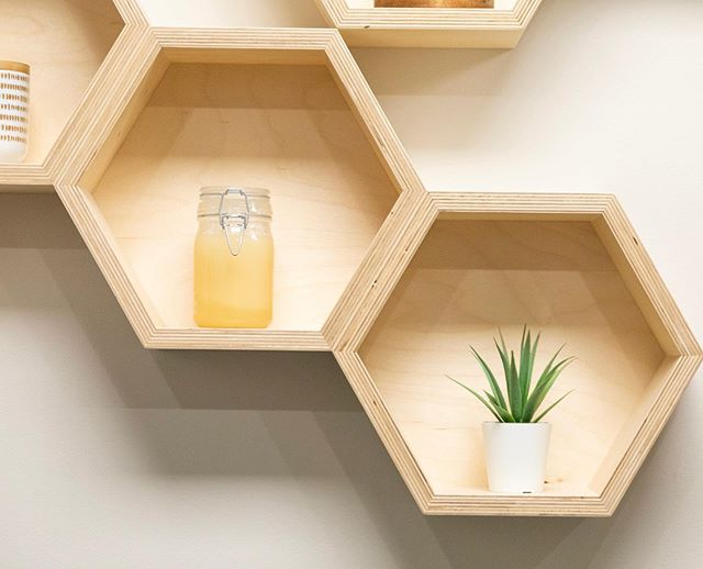 Custom details like this one add so much character and meaning to a space. We had these plywood display boxes made for a commercial client in Vancouver, and they turned out perfectly. . . #customdisplay #bespokedesign #plywoodfurniture #plywooddesign #hexagonshelves #designdetails #designisinthedetails #pattiszabodesign