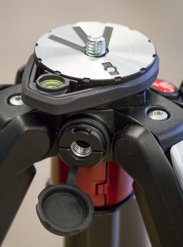 Close-up showing the adjustable spirit level (you can turn in around, so as not to clash with the head position), and the accessory attachment complete with rubber 'plug'.