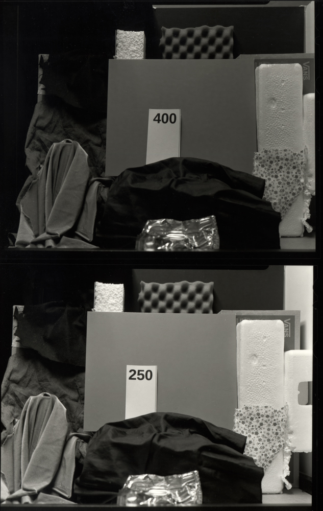 Contact prints of my personal film speed tests on 5x4 film. There is a clear difference between the manufacturer's recommended 400 ISO and 250. At 250 the shadows are much more open and the mid-grey much lighter and livelier.