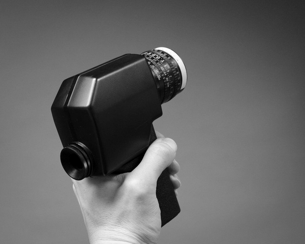 A handheld spot meter, essential zone system tool.