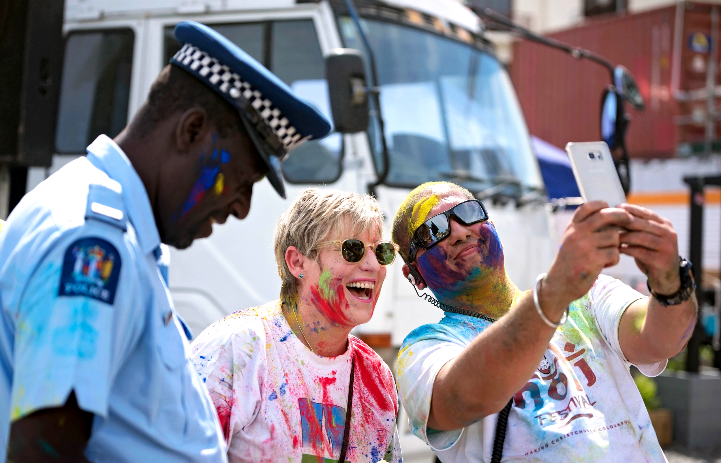 Constable Philemon Goto - Ethnic Liaison Officer of Canterbury Police, Christchurch's Mayor Lianne Dalziel and Hitesh Sharma, the main organiser of Christchurch's 2016 Holi celebrations