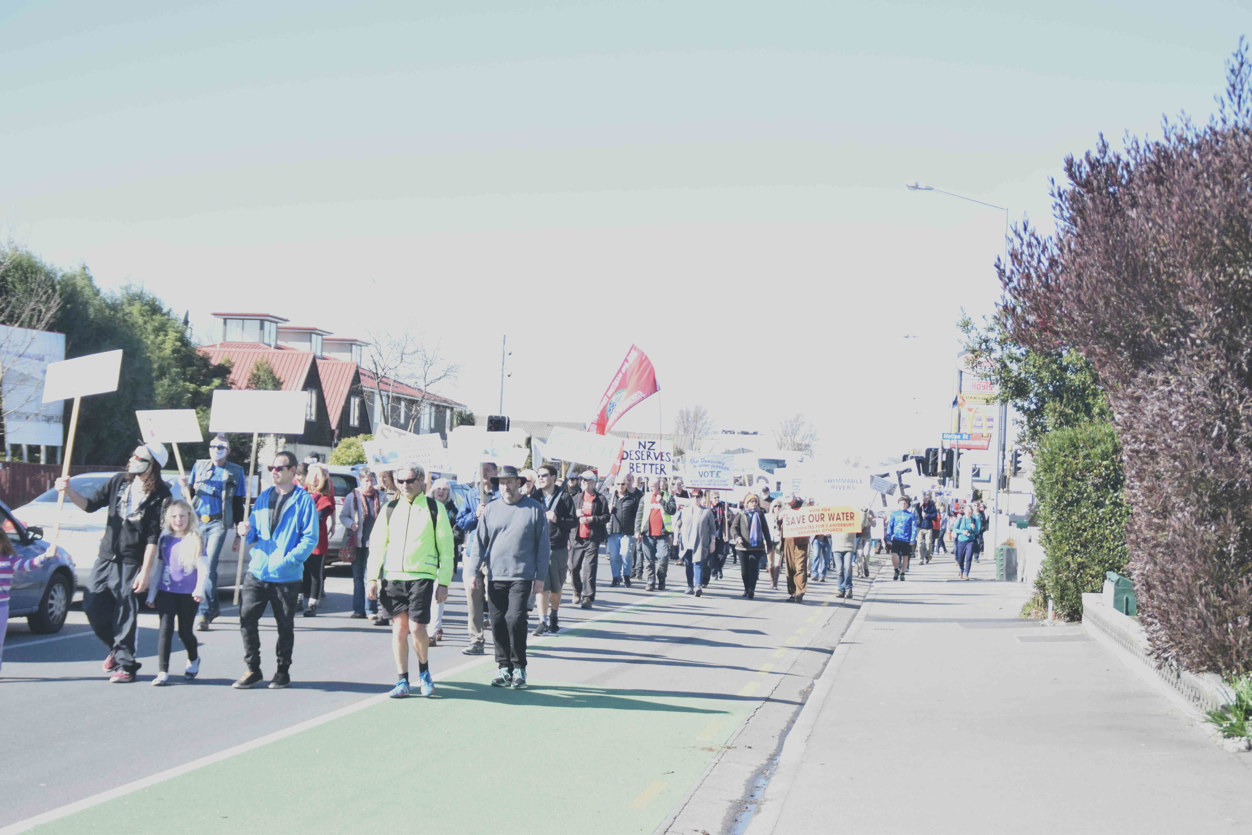 Anti-TPPA protestors marching on Riccarton Road in Christchurch on September 10