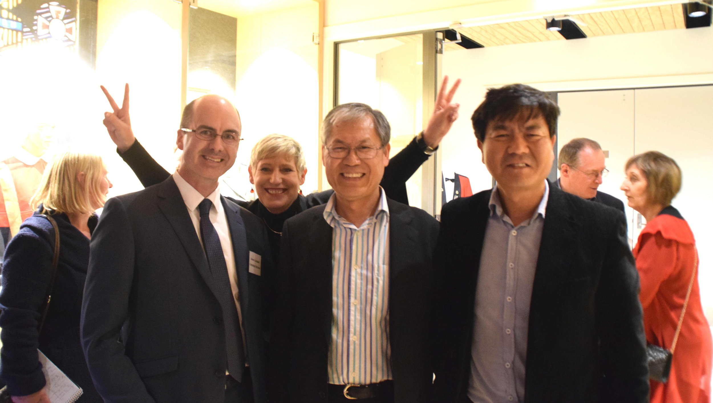 Mayor Lianne Dalziel (flashing the victory sign), with her campaign manager Aaron Cambpell (left), Councillor Jimmy Chen (middle), and Kevin Park of Canterbury Migrants Centre