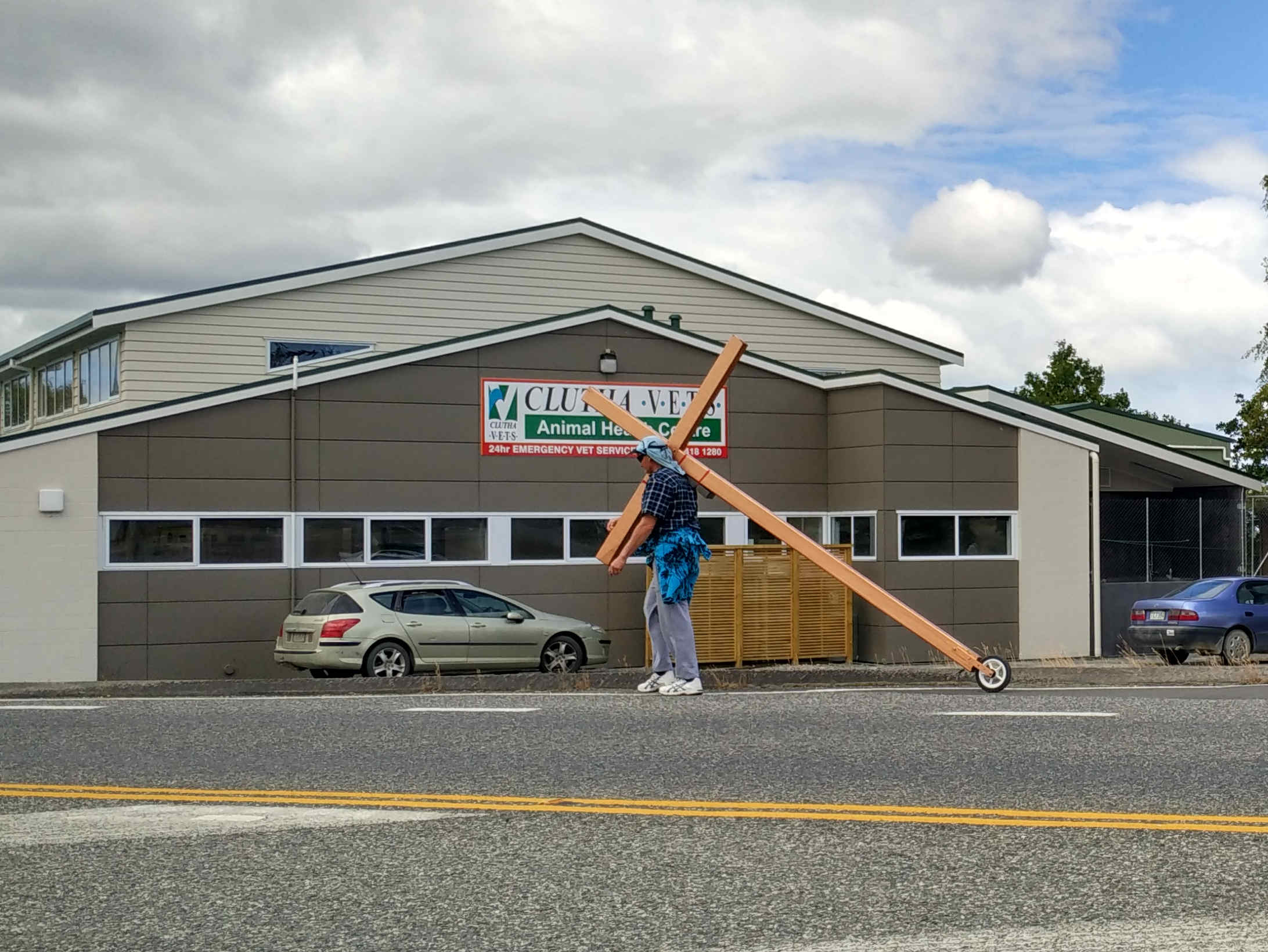 Kim Rusden who is spanning the length of the country carrying a cross, as seen in Clutha.