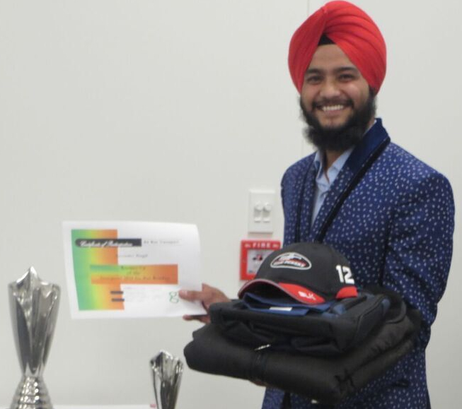 Arvinder Singh with the certificate and runners-up trophy