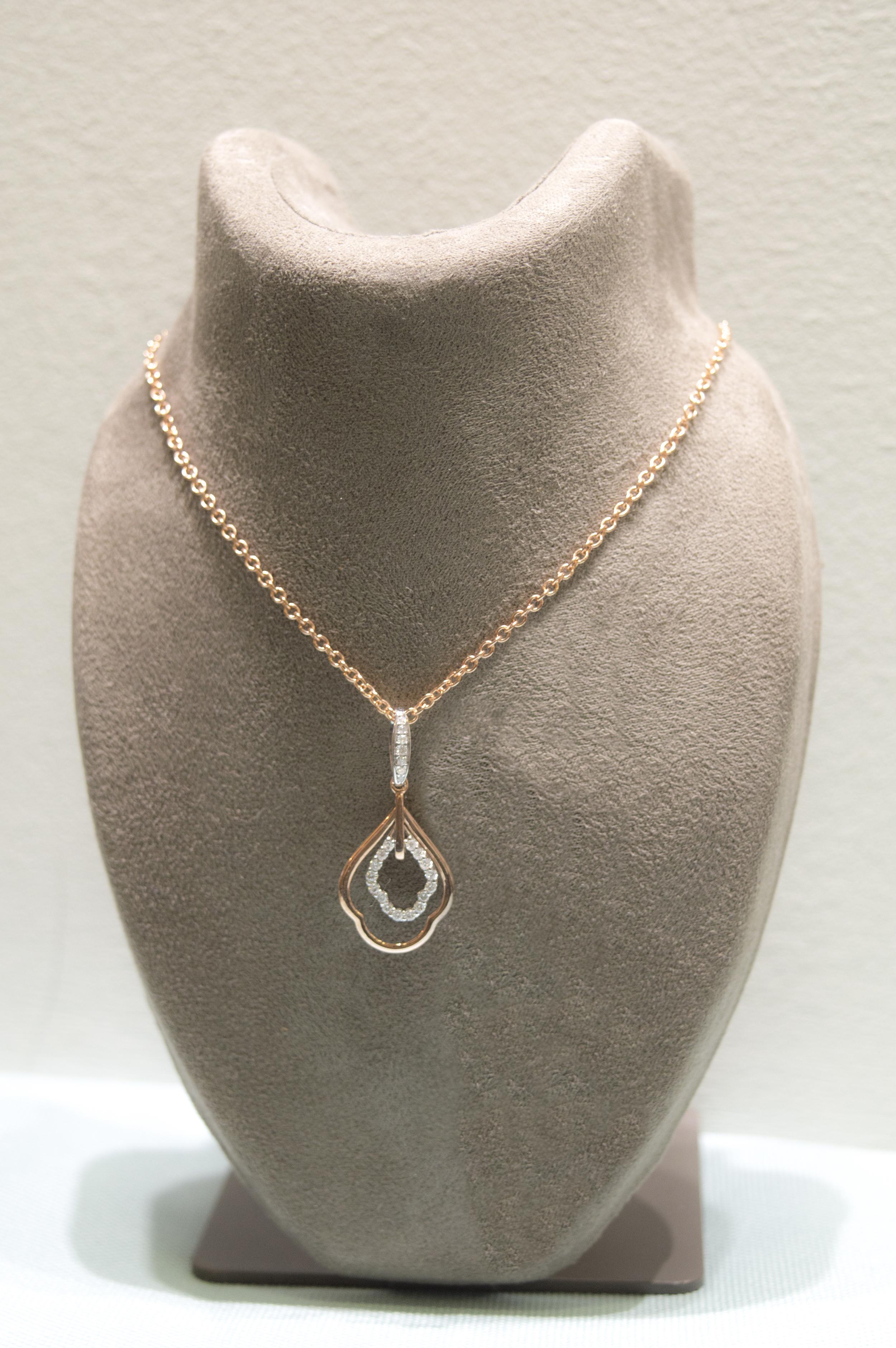 £525 - Diamond & 9ct Rose Gold Pendant
