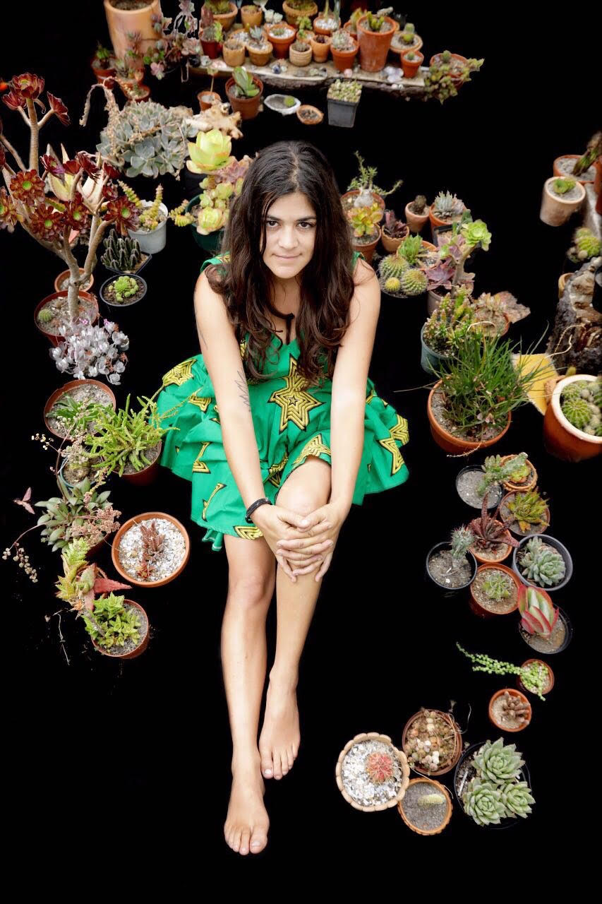Filipa Dominguez  with some of her plants.