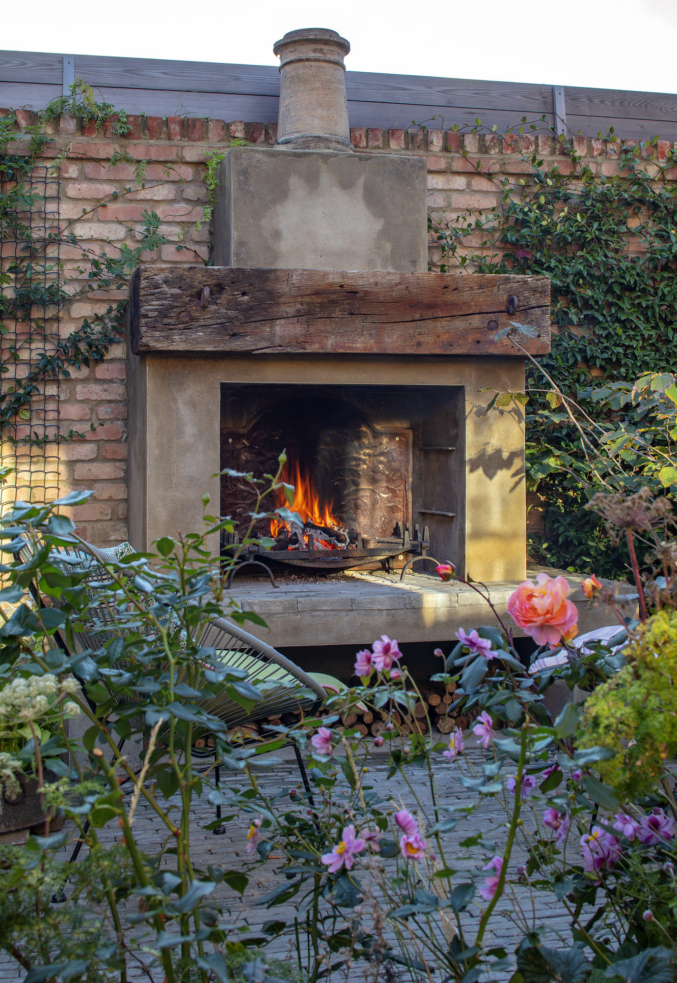 A fireplace in the courtyard garden. Photograph: Clive Nichols.