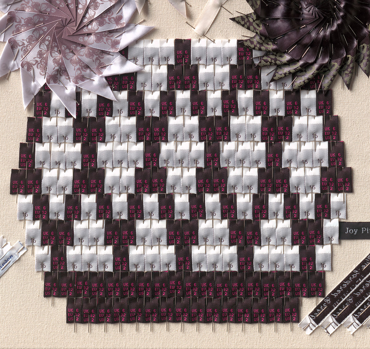 Joy Pitts_803 scrap clothing labels with dressmaker pins on canvas_2.jpg
